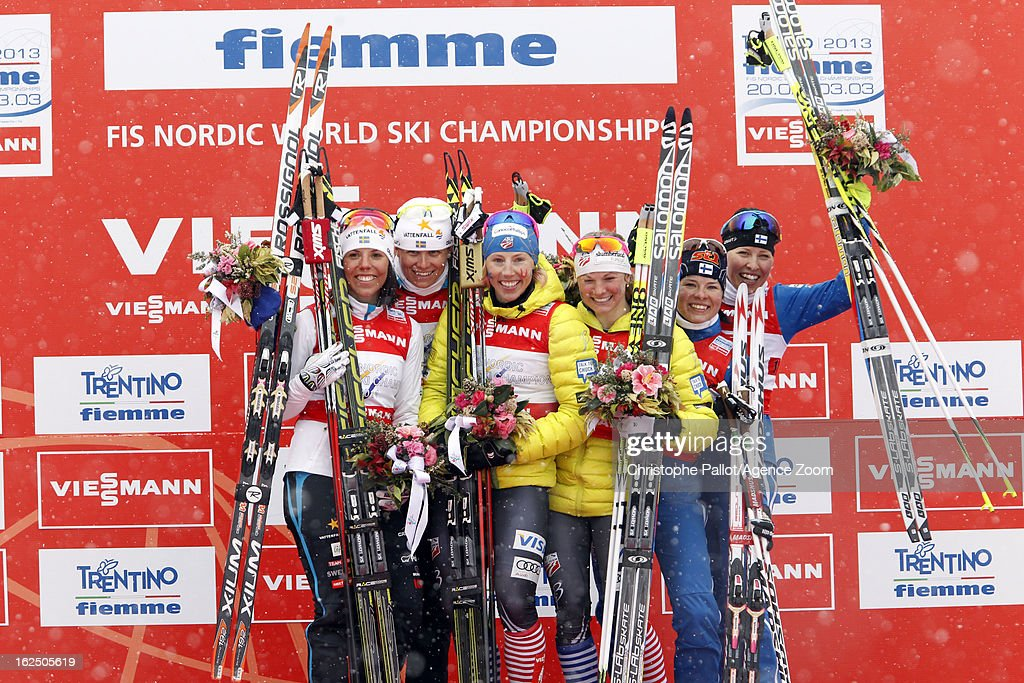 Jessica Diggins of the USA, Kikkan Randall of the USA take the gold medal, Charlotte Kalla of Sweden, Ida Ingemarsdotter of Sweden take the silver medal, Riikka Sarasoja-Lilja of Finland, Krista Lahteenmaki of Finland take the bronze medal during the FIS Nordic World Ski Championships Cross Country Women's Team Sprint on February 24, 2013 in Val di Fiemme, Italy.