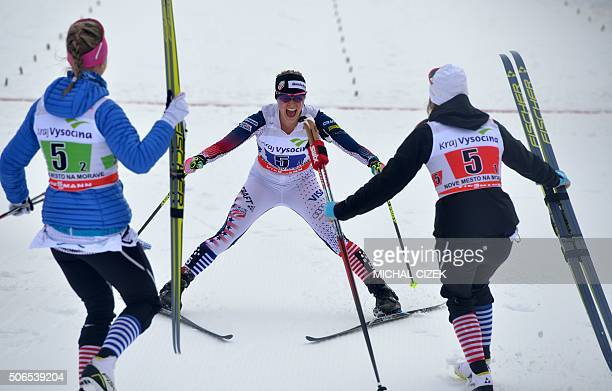 TOPSHOT Jessica Diggins of United States celebrates with her team mates Sophie Caldwell and Sadie Bjornsen during the women 4x5 km Relay Classic Free...