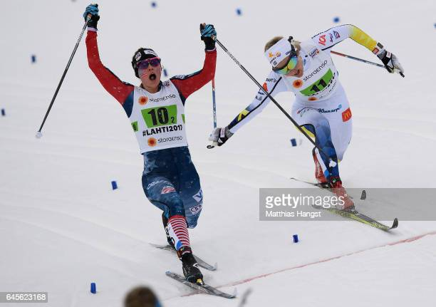 Jessica Diggins of USA celebrates after crossing the finish line before Stina Nilsson of Sweden in the Men's and Women's Cross Country Team Sprint...