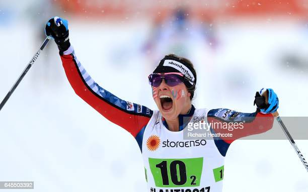 Jessica Diggins of USA celebrates winning 3rd place in the Men's and Women's Cross Country Team Sprint Final during the FIS Nordic World Ski...