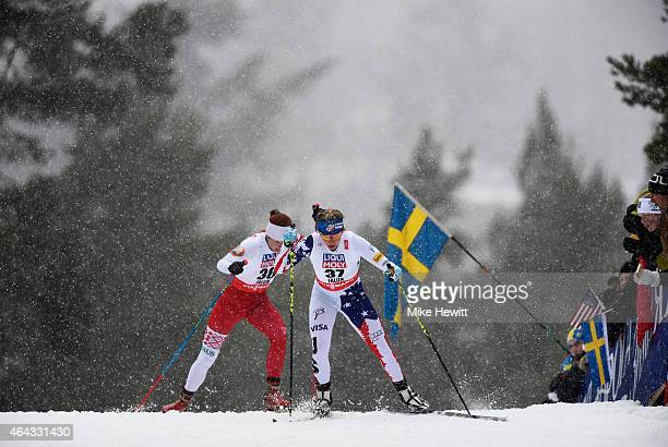 Jessica Diggins of USA competes with Ekaterina Rudakova of Belarus during the Women's 10km CrossCountry during the FIS Nordic World Ski Championships...