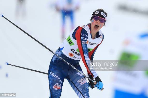 Jessica Diggins of USA crosses the finish line before Stina Nilsson of Sweden to claim bronze in the Women's Cross Country Team Sprint Final during...