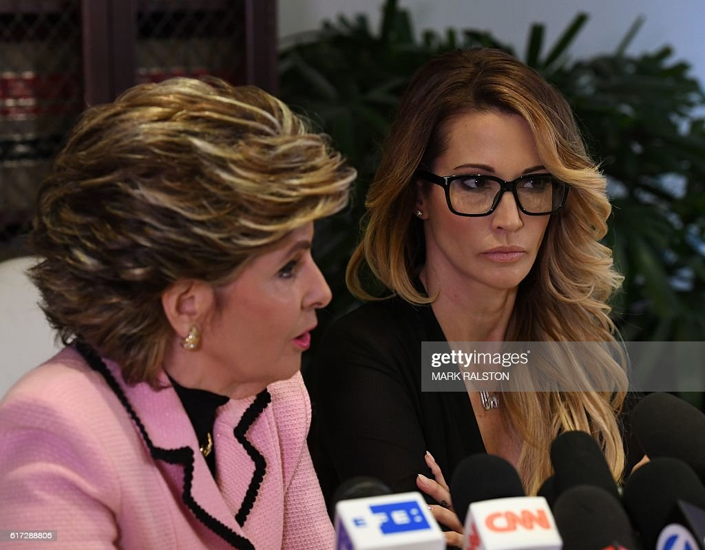 jessica drake (R), who works for an adult film company, speaks beside attorney Gloria Allred about allegations of sexual misconduct against Republican presidential hopeful Donald Trump during a press conference in Los Angeles on October 22, 2016. / AFP / Mark RALSTON