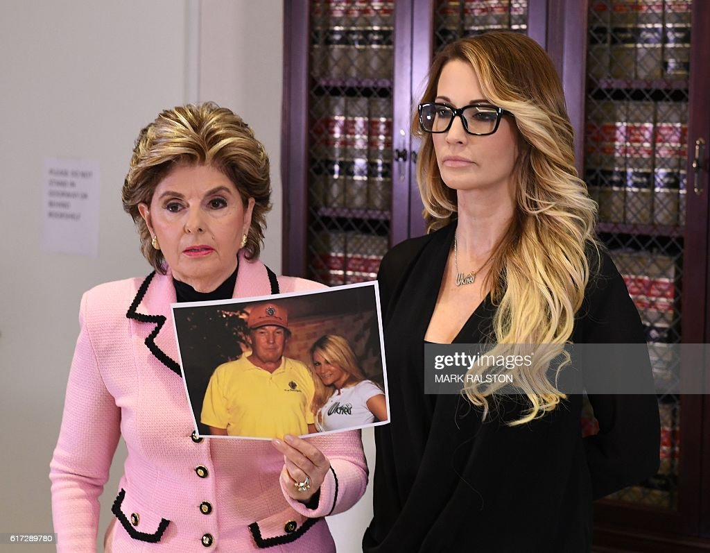 jessica drake (R), who works for an adult film company, speaks beside attorney Gloria Allred (L) about allegations of sexual misconduct against Republican presidential hopeful Donald Trump during a press conference in Los Angeles, California on October 22, 2016. / AFP / Mark RALSTON