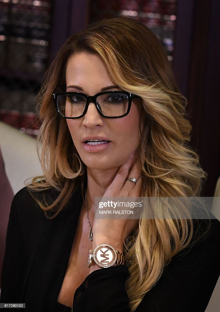 jessica drake, who works for an adult film company, speaks beside attorney Gloria Allred about allegations of sexual misconduct against Republican presidential hopeful Donald Trump during a press conference in Los Angeles, California on October 22, 2016. / AFP / Mark RALSTON