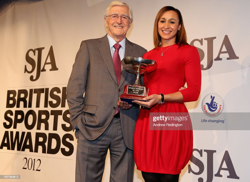 Jessica Ennis of England receives the SJA Sportswoman Of The Year award from Sir Michael Parkinson during the SJA 2012 British Sports Awards at The Pavilion at the Tower of London on December 6, 2012 in London, England.
