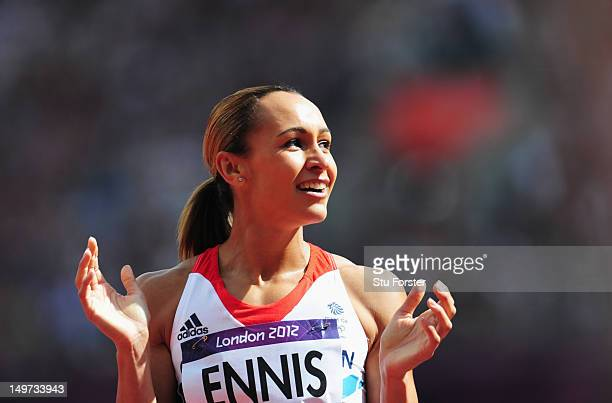 Jessica Ennis of Great Britain looks to the scoreboard after competing in the Women's Heptathlon 100m Hurdles Heat 1 on Day 7 of the London 2012...