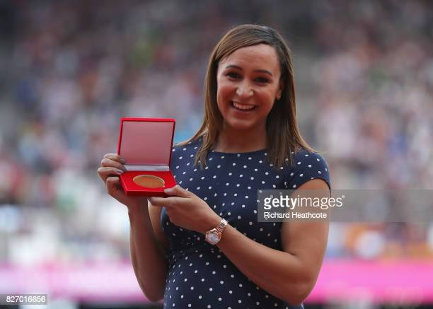 Jessica Ennis of Great Britain receives her reallocated gold medal for the Women's Heptathlon at the 2011 Daegu Championships during day three of the...