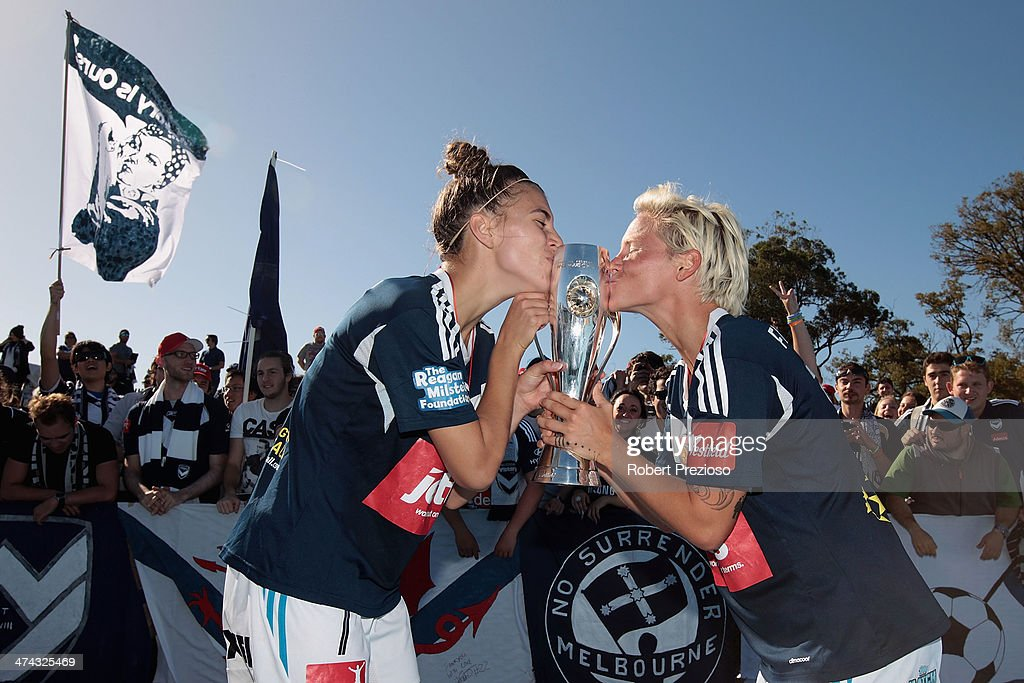 Jessica Fishlock and Stephanie Catley of Victory celebrate after winning the W-League Grand Final match between the Melbourne Victory and the Brisbane Roar at Lakeside Stadium on February 23, 2014 in Melbourne, Australia.