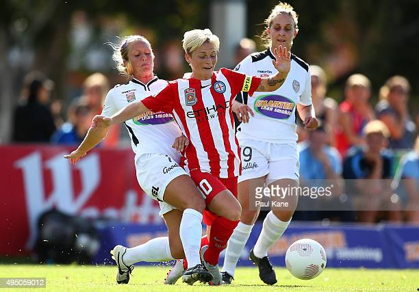 Jessica Fishlock of City is challenged by Nicole Stanton of the Glory during the round three WLeague match between Perth Glory and Melbourne City FC...