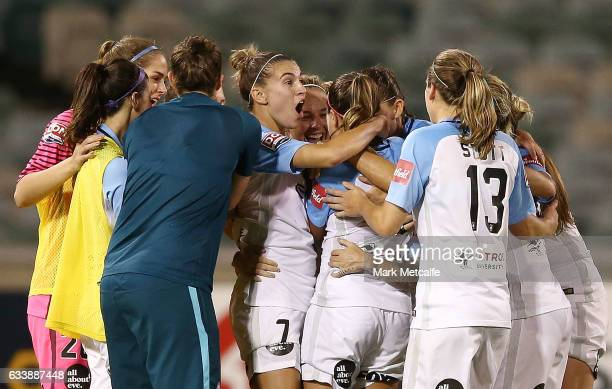 Jessica Fishlock of Melbourne City celebrates scoring a goal with team mates during the WLeague Semi Final match between Canberra United and...