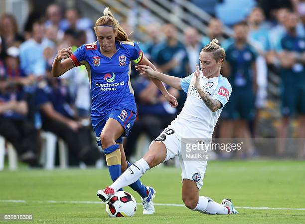 Jessica Fishlock of Melbourne City competes for the ball against Gema Simon of the Jets during the round 14 WLeague match between the Newcastle Jets...