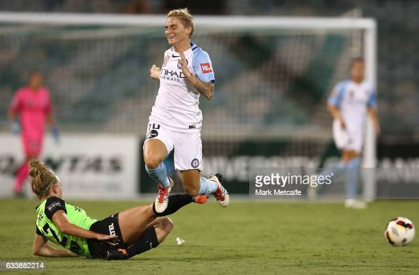 Jessica Fishlock of Melbourne City is tackled by Hannah Brewer of Canberra during the WLeague Semi Final match between Canberra United and Melbourne...