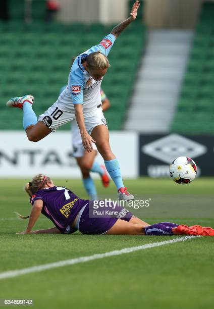 Jessica Fishlock of Melbourne City jumps over Nicole Stanton of the Perth Glory after being tackled during the 2017 WLeague Grand Final match between...