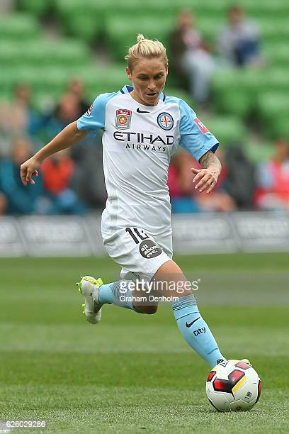 Jessica Fishlock of Melbourne City runs with the ball during the round four ALeague match between Melbourne City FC and Melbourne Victory at AAMI...