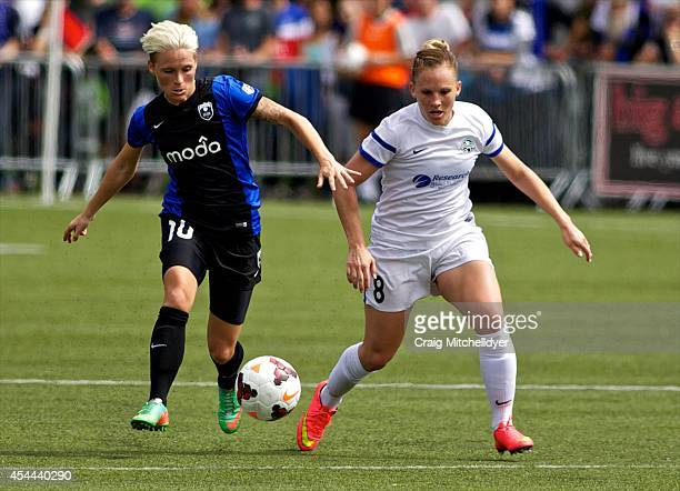 Jessica Fishlock of Seattle Reign FC and Amy Rodriguez of FC Kansas City fight for the ball in the second half of the National Women's Soccer League...