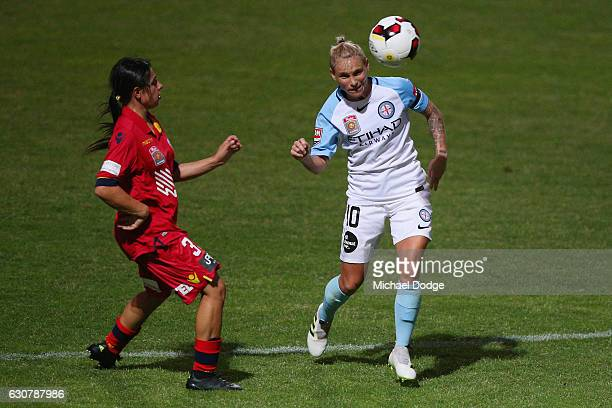 Jessica Fishlock of the City heads the ball away from Alexandra Chidiac of United during the round 10 WLeague match between Melbourne City and...