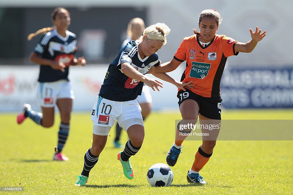 Jessica Fishlock of Victory and Ayesha Norrie of Roar contest the ball during the W-League Grand Final match between the Melbourne Victory and the Brisbane Roar at Lakeside Stadium on February 23, 2014 in Melbourne, Australia.