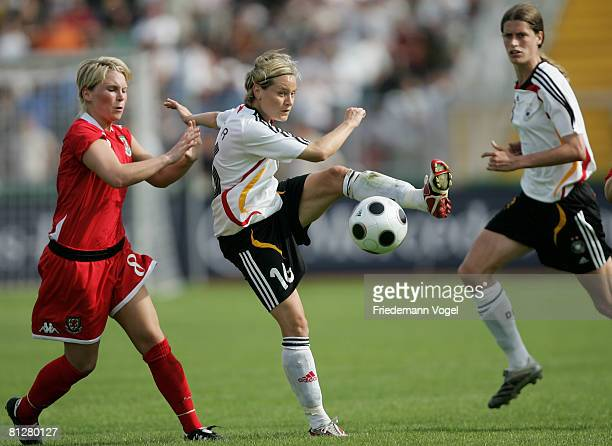 Jessica Fishlock of Wales battles for the ball with Martina Mueller of Germany during the Women's Euro 2009 qualifier between Germany and Wales at...