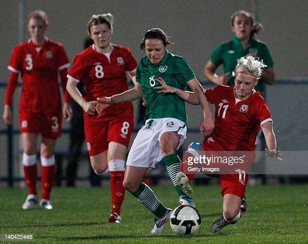Jessica Fishlock of Wales challenges Aine O'Gorman of Ireland during the Women Algarve Cup match between Wales and Ireland on March 2 2012 in...