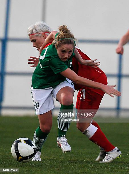 Jessica Fishlock of Wales challenges Julie Ann Russell of Ireland during the Women's Algarve Cup match between Wales and Ireland on March 2 2012 in...