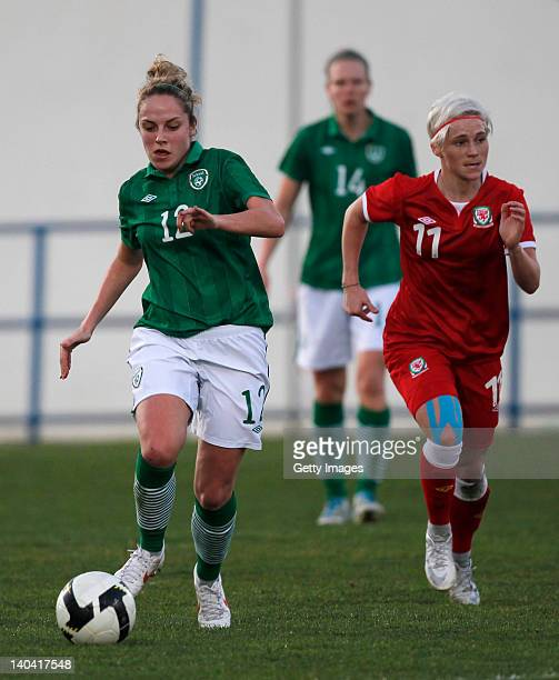 Jessica Fishlock of Wales in action with Julie Ann Russell of Ireland during the Women Algarve Cup match between Wales and Ireland on March 2 2012 in...