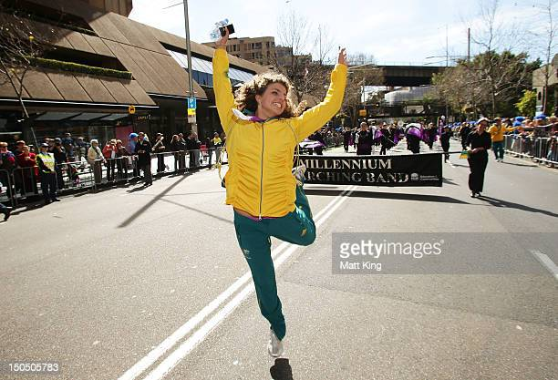 Jessica Fox celebrates during the Australian Olympic Team Homecoming Parade in the Sydney CBD on August 20 2012 in Sydney Australia