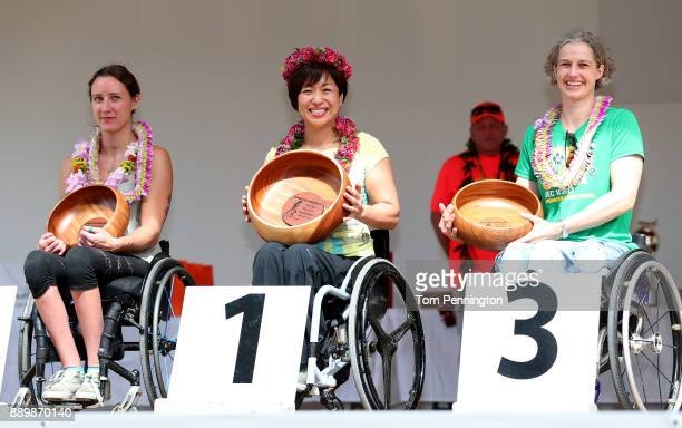 Jessica Frotten in second place Wakako Tsuchida in first place and Marianne Maiboll in third place during the awards ceremony for the Women's Wheel...