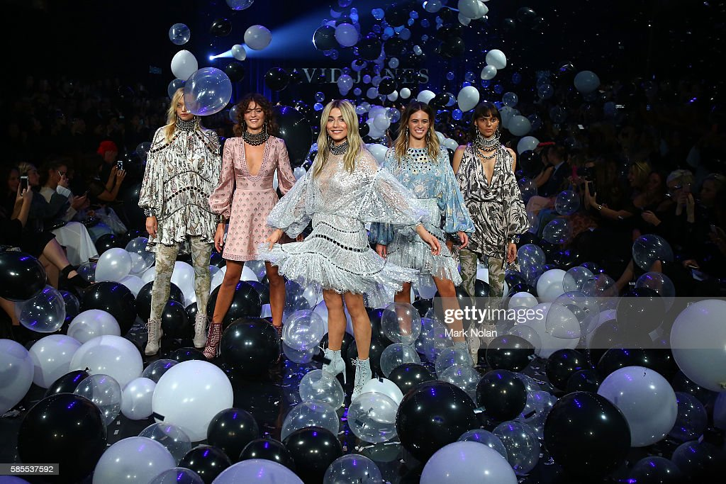 Jessica Gomes and models showcase designs by Zimmerman on the runway at the David Jones Spring/Summer 2016 Fashion Launch at Fox Studios on August 3...