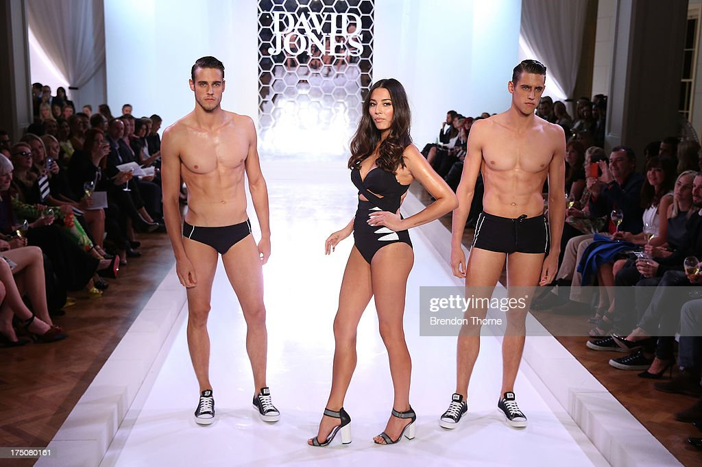 Jessica Gomes, and Zac and Jordan Stenmark showcases designs by Jets at the David Jones Spring/Summer 2013 Collection Launch at David Jones Elizabeth Street on July 31, 2013 in Sydney, Australia.
