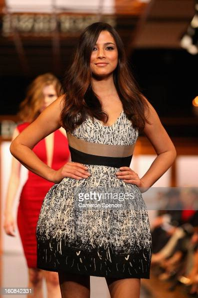 Jessica Gomes showcases designs by Alex Perry on the runway during the David Jones A/W 2013 Season Launch at David Jones Castlereagh Street on...