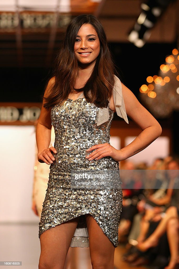 Jessica Gomes showcases designs by Rachel Gilbert on the runway during the David Jones A/W 2013 Season Launch at David Jones Castlereagh Street on February 6, 2013 in Sydney, Australia.