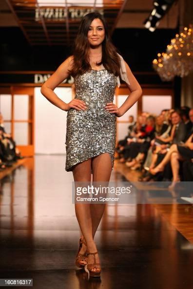 Jessica Gomes showcases designs by Rachel Gilbert on the runway during the David Jones A/W 2013 Season Launch at David Jones Castlereagh Street on...