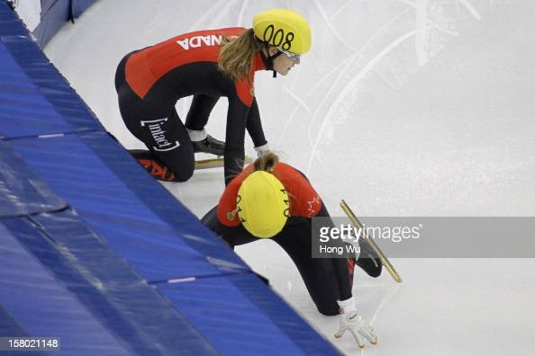Jessica Gregg and Marianne Stgelais of Canada fall down in the Women's 500m Final during the day two of the ISU World Cup Short Track at the Oriental...