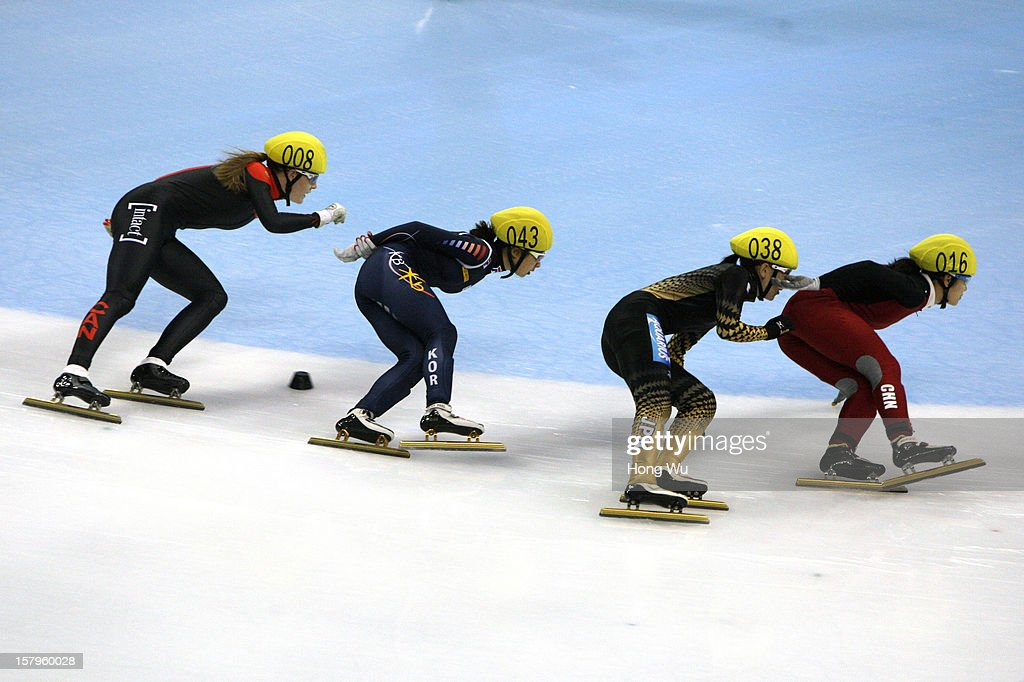 Jessica Gregg of Canada, Soyoun Lee of Korea, Sayuri Shimizu of Japan, Qiuhong Liu of China compete in the Women's 1000m Quarter final during the day one of the ISU World Cup Short Track at the Oriental Sports Center on December 8, 2012 in Shanghai, China.