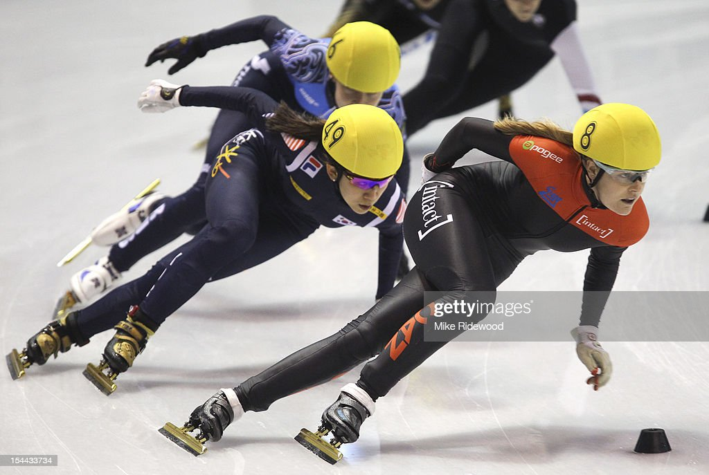 Jessica Gregg of Canada stays ahead of HaRi Cho of Korea in women's 1000 meter preliminaries at the Samsung ISU short track speed skating World Cup...