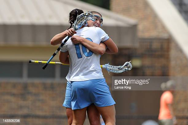 Jessica Griffin and Becky Lynch of the North Carolina Tar Heels celebrate following a goal by Jessica Griffin against the Virginia Cavaliers during...