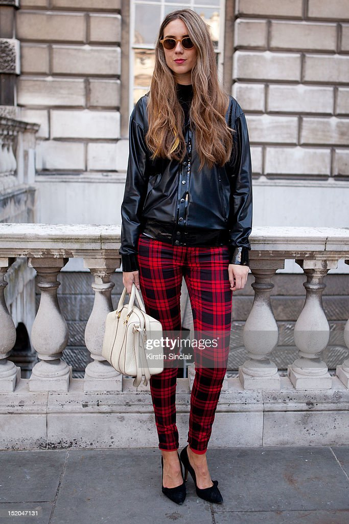 Jessica Hannan wearing village Bicycle trousers, Latex Hoodie from a sex shop in Paris, Mimba and Lola Bag, Housemates glasses and Aldo shoes on day 2 of London Fashion Week Spring/Summer 2013, at Somerset House on September 15, 2012 in London, England.