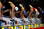 Jessica Hardy and Dara Torres stand on the starting block as they prepare to compete in preliminary heat 16 of the Women's 50 m Freestyle during Day...