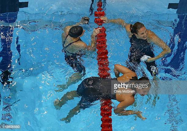 Jessica Hardy of the United States joins Marieen Veldhuis of Netherlands and Ranomi Kromowidjojo of Netherlands after the Women's 50m Freestyle Final...
