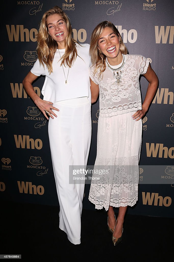 Jessica Hart (L) and Ashley Hart pose at WHO's sexiest people party 2014 at Fox Studios on October 22, 2014 in Sydney, Australia.