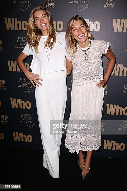 Jessica Hart and Ashley Hart pose at WHO's sexiest people party 2014 at Fox Studios on October 22 2014 in Sydney Australia