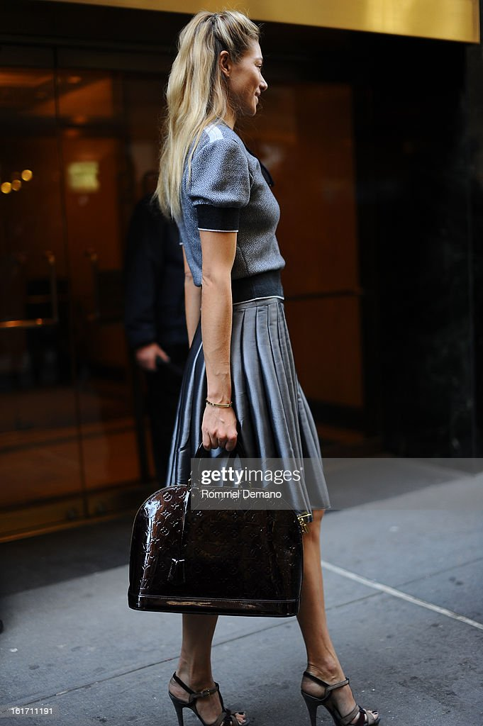 Jessica Hart attends the Calvin Klein show wearing a Louis Vuitton bag on February 14 2013 in New York City