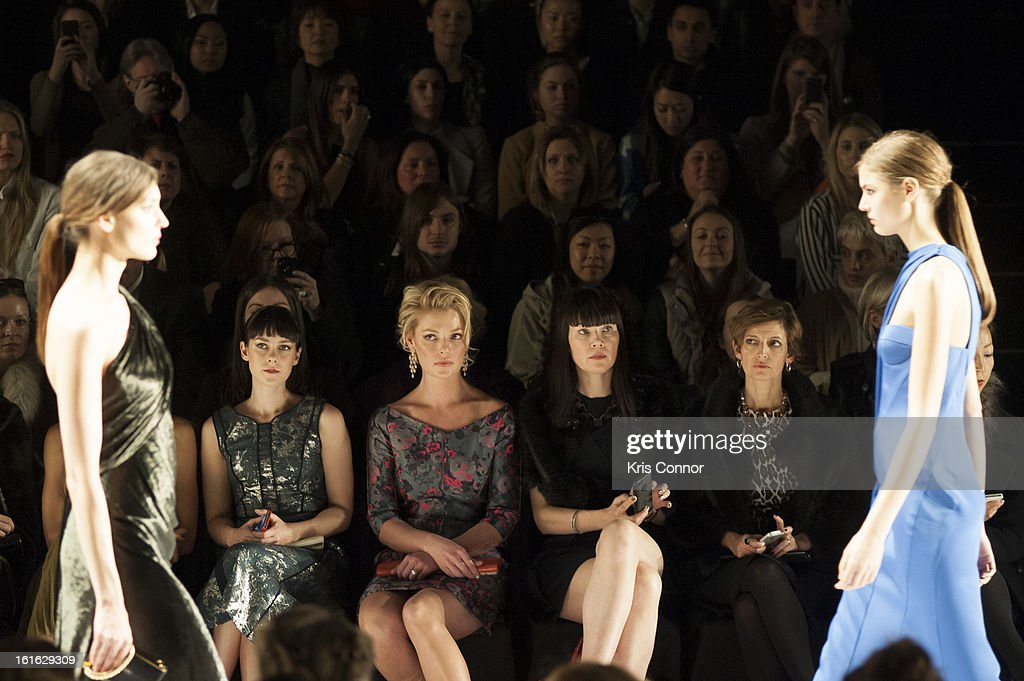 Jessica Heart, Jena Malone and Cindy Leive watch the J. Mendel Fall 2013 Mercedes-Benz Fashion Show at The Theater at Lincoln Center on February 13, 2013 in New York City.