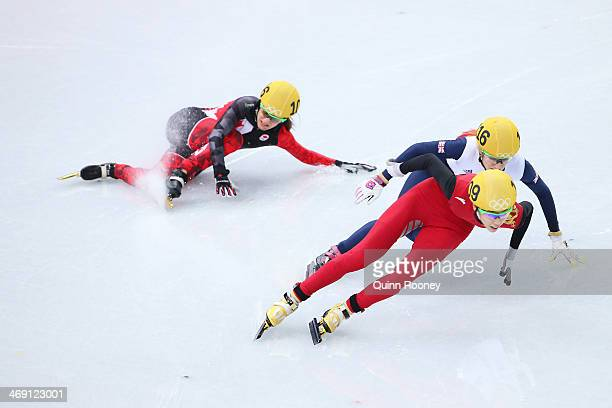 Jessica Hewitt of Canada falls as she competes with Elise Christie of Great Britain and Kexin Fan of China in the Women's Short Track 500m heats on...