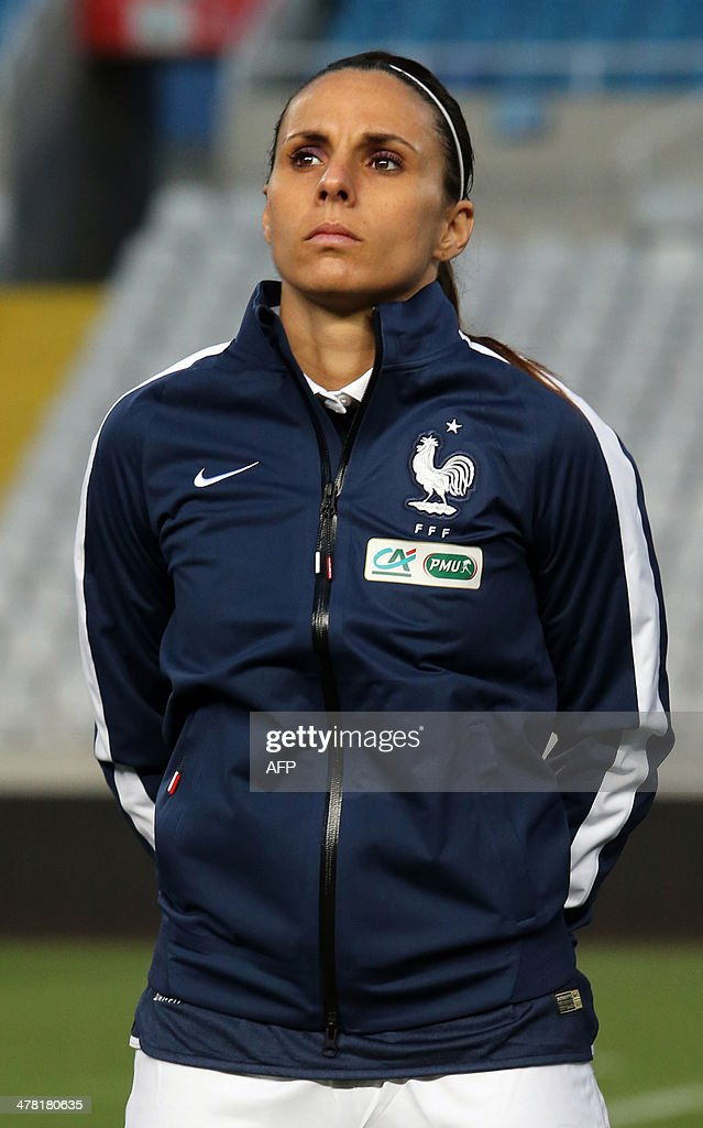 Jessica Houara, a player in France's women's national football team, listens to her national anthem prior to their Cyprus Women's Cup final against England at the Neo GSP stadium in Nicosia on March 12, 2014.