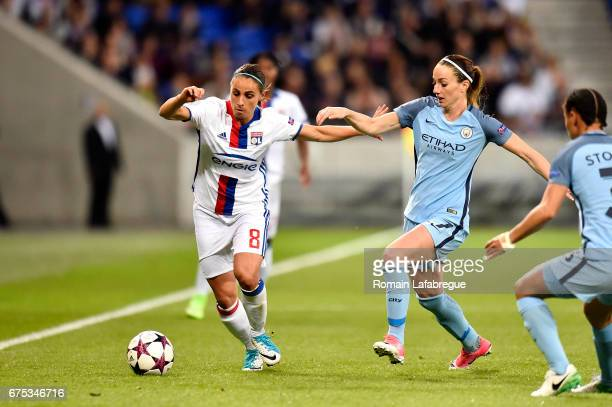 Jessica Houara D Hommeaux of Lyon Kosovare Asllani of Manchester during the Women's Champions League match between Olympique Lyonnais and Manchester...
