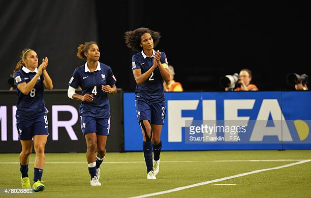 Jessica Houara Laura Georges and Wendie Renard of France celebrate at the end of the FIFA Womens's World Cup round of 16 match between France and...