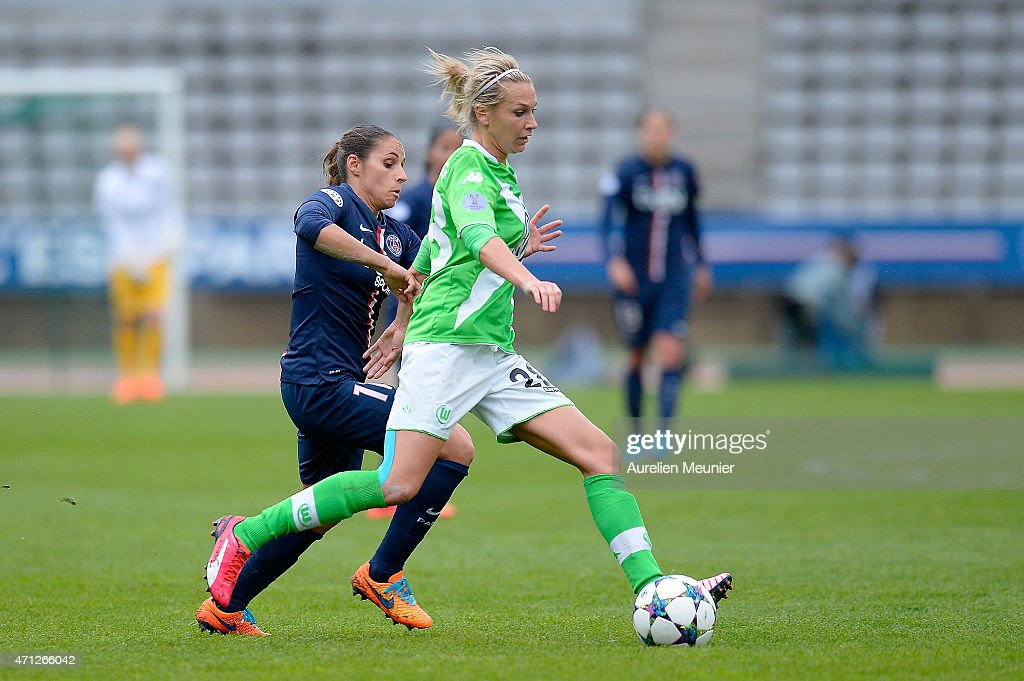 <a gi-track='captionPersonalityLinkClicked' href=/galleries/search?phrase=Jessica+Houara&family=editorial&specificpeople=6380286 ng-click='$event.stopPropagation()'>Jessica Houara</a> (L) of PSG and <a gi-track='captionPersonalityLinkClicked' href=/galleries/search?phrase=Lena+Goessling&family=editorial&specificpeople=639252 ng-click='$event.stopPropagation()'>Lena Goessling</a> (R) of VfL Wolfsburg in action during the UEFA Womens Champions League Semifinal game between Paris Saint Germain and VfL Wolfsburg at Stade Charlety on April 26, 2015 in Paris, France.