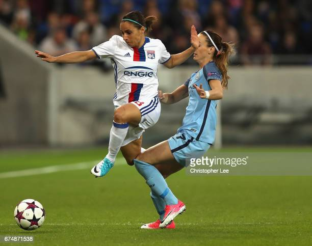 Jessica HouaraDHommeaux of Olympique Lyon jumps a tackle from Kosovare Asllani of Manchester City during the UEFA Women's Champions League Semi Final...